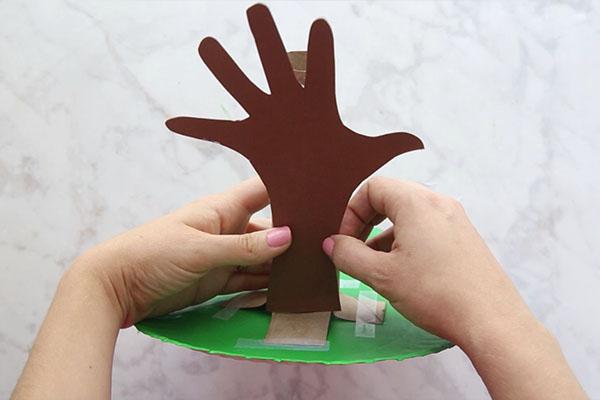 Glue Handprint on Paper Towel Tube