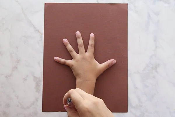 Trace hand on Brown Paper