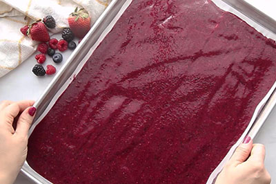Spread fruit roll up on pan