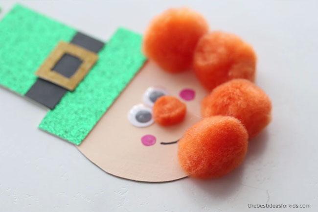 Glue Pom Poms to Leprechaun Face