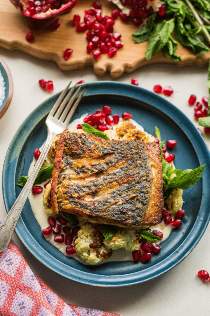 Pan Seared Fish with Cauliflower, Tahini, Pomegranate featuring Australis Barramundi