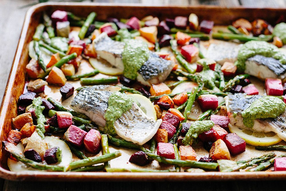 Barramundi Sheet Pan Dinner with Spring Vegetables and Pesto