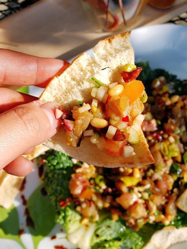 Mediterranean-Style Barramundi Poke on a Toasted Pita Chip