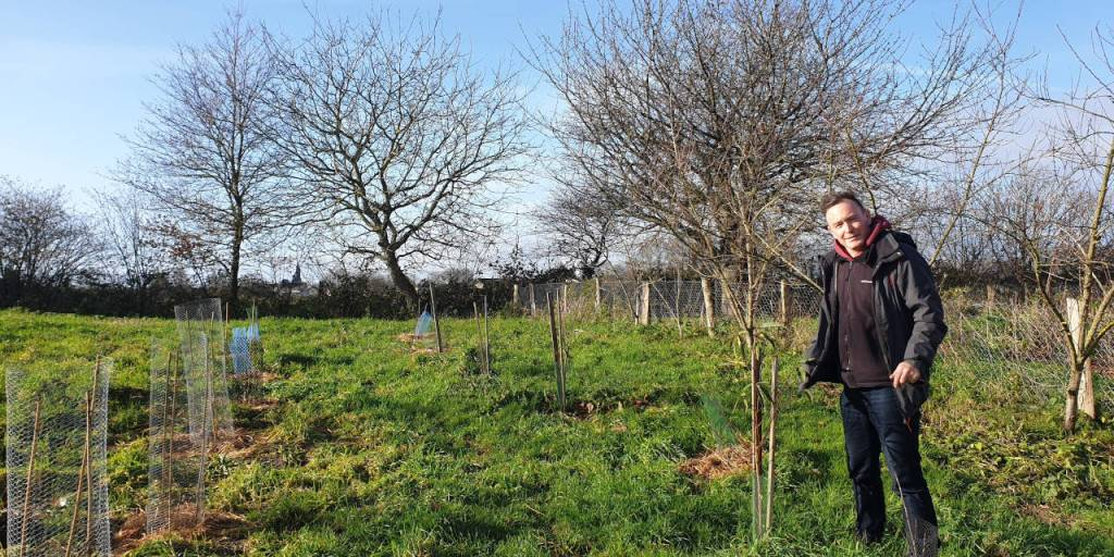 Alexis in the orchard