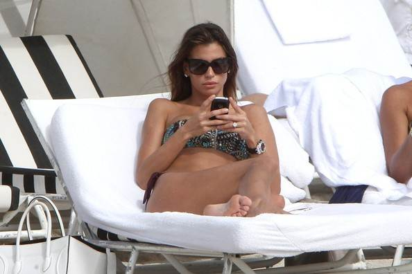 Claudia Galanti-Relaxing-In-The-Sun-In-A-Bandeau-Thong-Bikini
