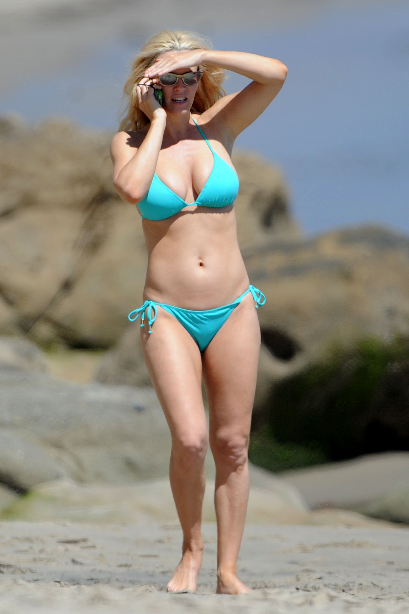 Jenny McCarthy shows off her bikini body on the beach with boyfriend Paul Krepelka