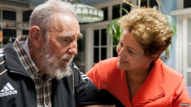 castro in old age talking to Brazil's President Dilma Rousseff