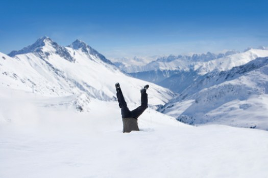Man upside-down in snow on mountain