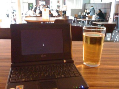 Me working online from a pub by the beach in 2014!