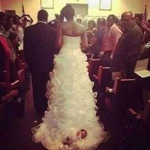 woman-ties-baby-wedding-train