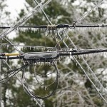 close up of ice on electricity transmission lines