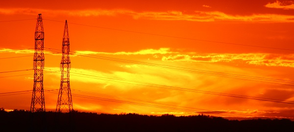 Electricity pylons & transmission lines on Hydro-Québec transmission network in Canada with the background of an orange sky