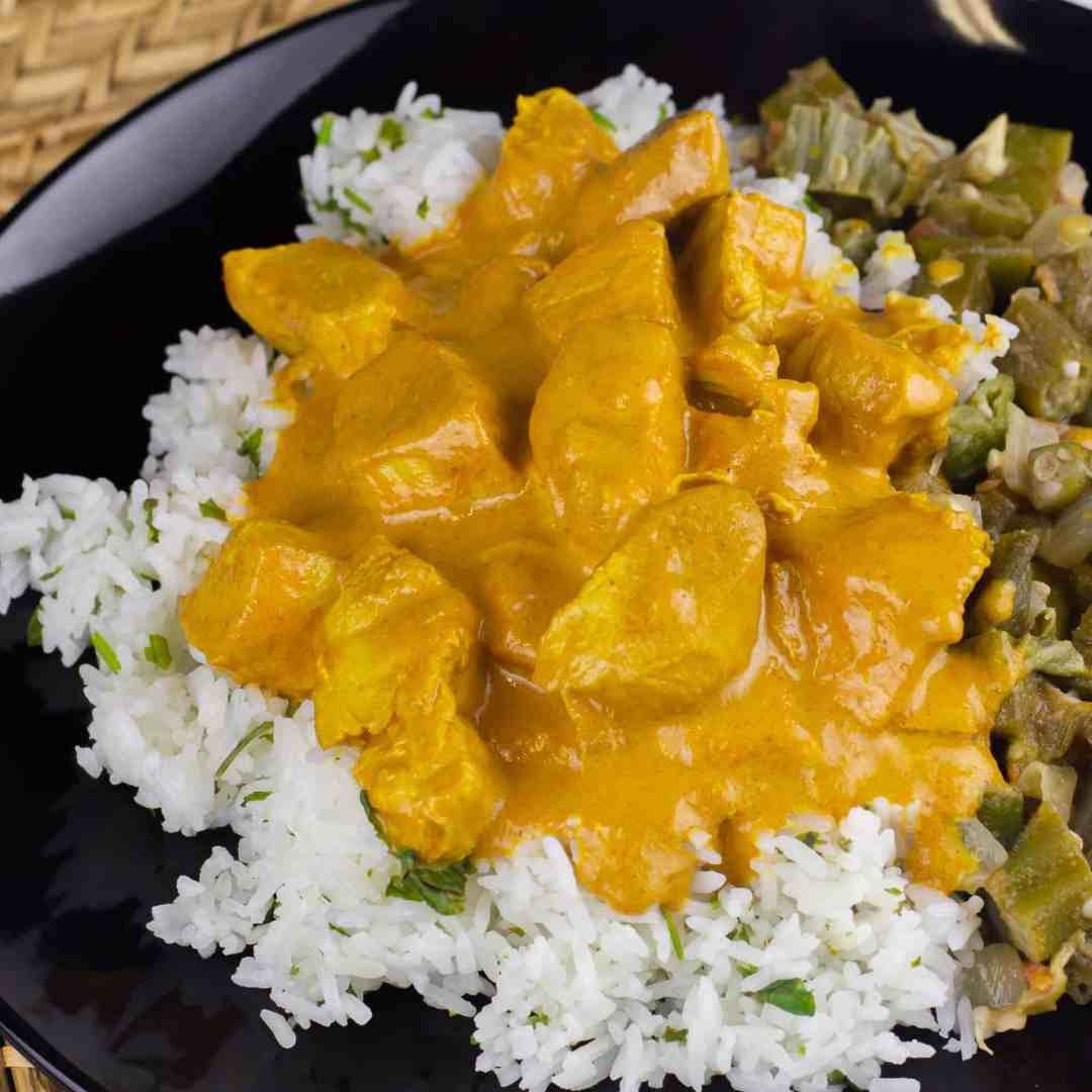 Crock Pot Chicken Tikka Masala recipe that is creamy and mild Indian curry (like butter chicken). Make in the slow cooker and serve on rice.