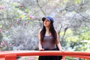 woman in gray tank top and black cap