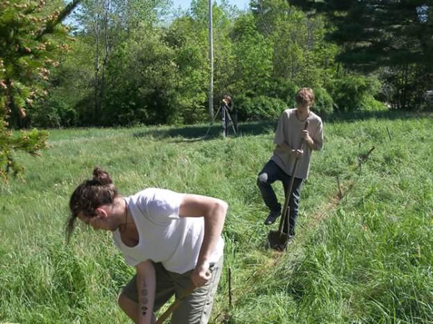 Surveying and digging a swale