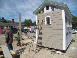 The siding going on, with the Farmers' Market going on too!