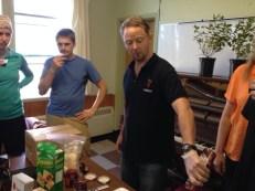 Liam Taylor pours Haskap juice for tasting