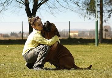 woman hug dog
