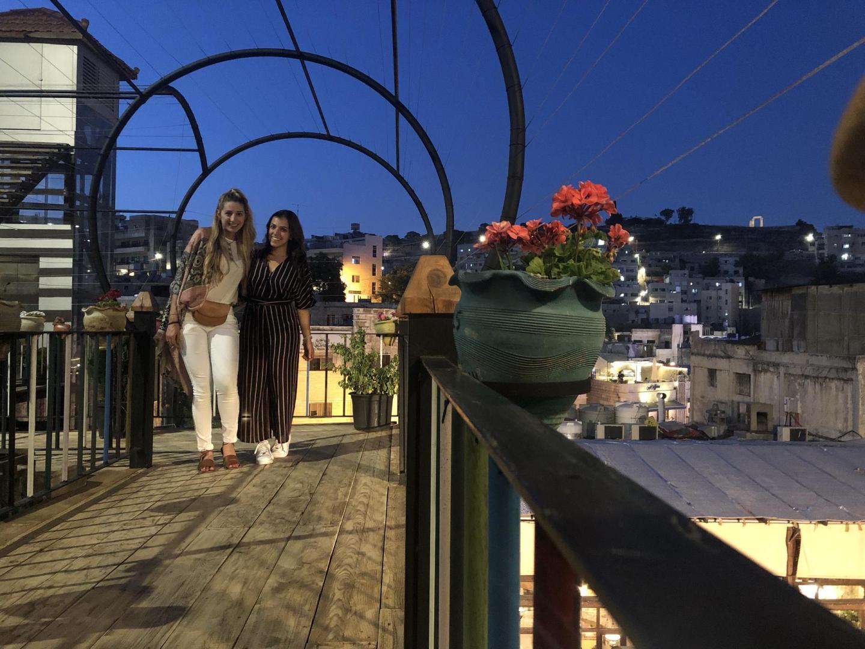 Two women in a balcony in Jordan.