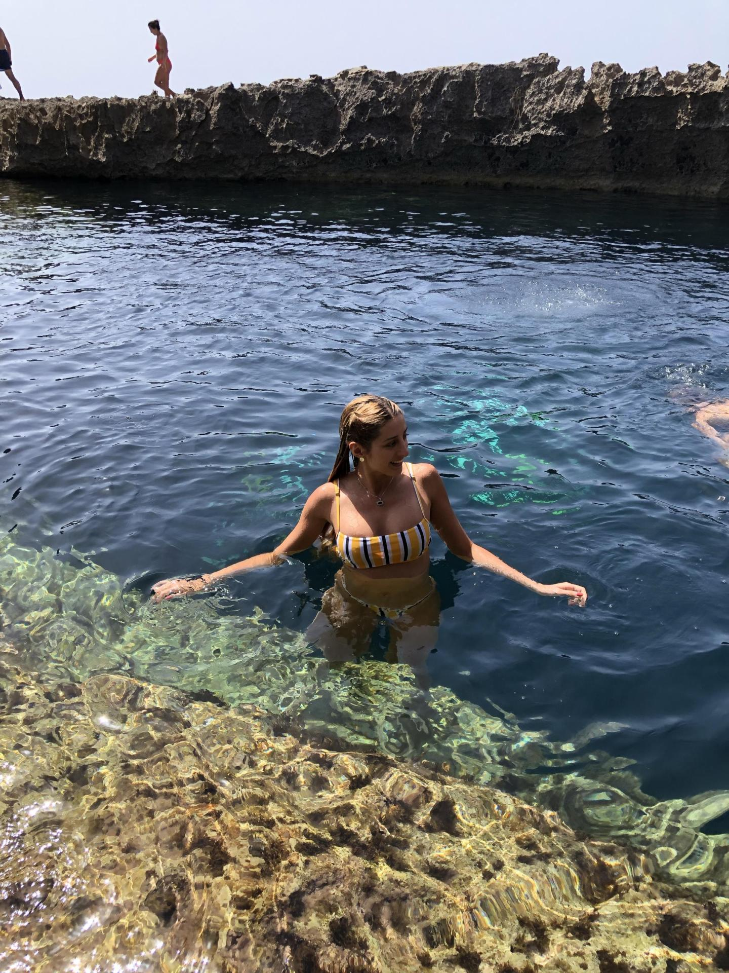 Woman in the water of a natural pool.