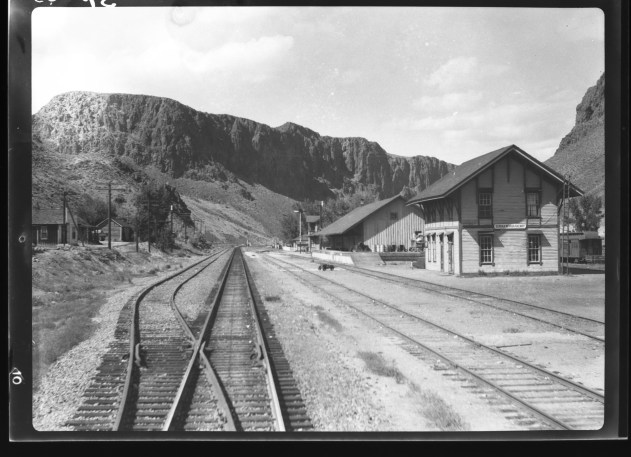 Palisade, Nevada as seen from the back of a Southern Pacific passenger train in the 1930's. Note the narrow gauge passenger car on the right. This was the location of the Eureka - Nevada Railroad shops, formerly the Eureka and Palisade.