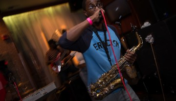 Performer Gray Poupon brings a full show whenever he touches a mic by rapping, singing and playing his saxophone with style and flair.