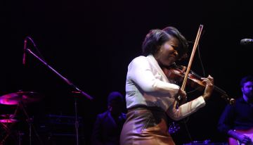 Violinist Kendall Isadaore pops the strings of her violin playing so fiercely!