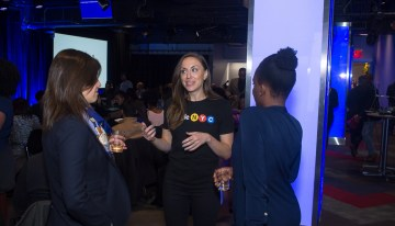 "Molly Welch (Diversity & Inclusion Marketing, Google) engages with attendees at Google's ""A Seat at the Table: Inclusion and Innovation in Technology & Society""Photo by Bernard Smalls"