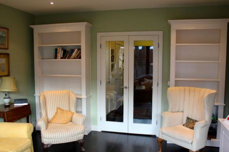 Matching pair bookcases in London home