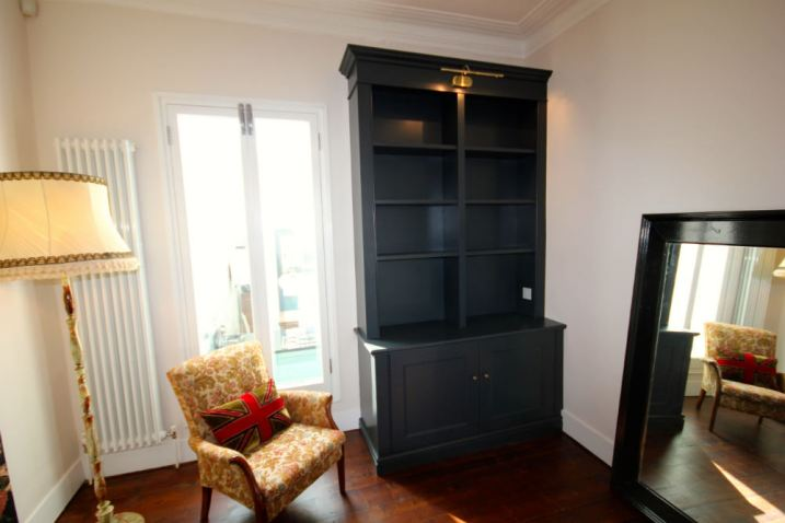 Purpose built bookcase:cupboard unit finished with Farrow & Ball colour in Wandsworth