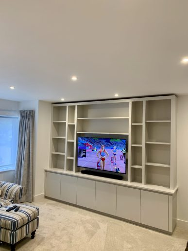 Customised media bookcase with cabinet storage