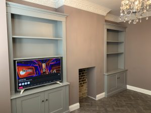 Purpose built alcove units either side of chimney breast