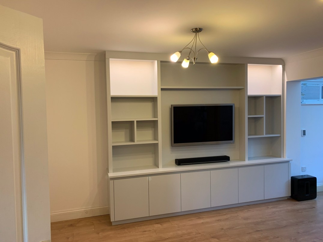 Contemporary media unit with random styled shelving