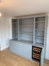 Freestanding contemporary bookshelf with integrated wine cooler