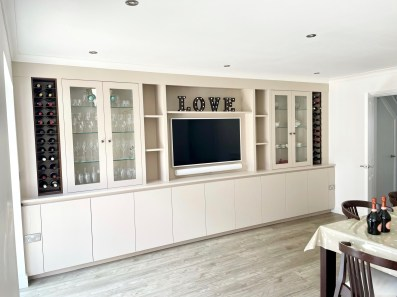 wall to wall media bookcase with wine racking