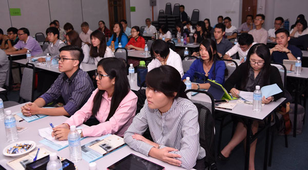 A view of participants concentrating during a presentation.