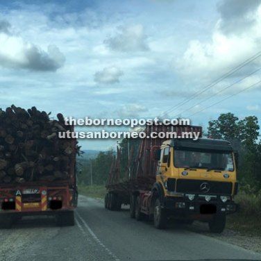 Heavy vehicles plying Jalan Samarakan in Tatau, which are allegedly damaging the road.