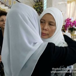 Fatimah consoles Jamilah (right) at her residence in Santubong in conjunction with Adenan's birthday on Jan 27.