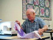 A senior citizen learns quilting in order to keep sharp. Source: NPR.