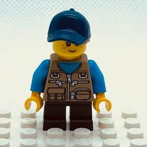 LEGO Minifigure Girl, Freckles, Dark Tan Vest Over Dark Azure Shirt, Dark Blue Cap