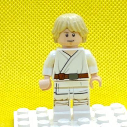 LEGO Minifigure Luke Skywalker (Tatooine, White Legs, Stern / Smile Face Print)