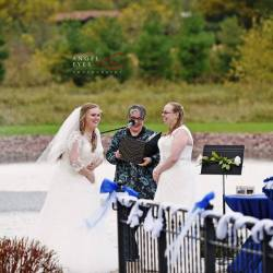 Outdoor ceremony - on a windy day! Photo by Angel Eyes Photography