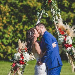 First kiss at a wicked outdoor wedding