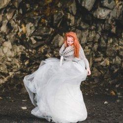Bride in Iceland dancing in the rain
