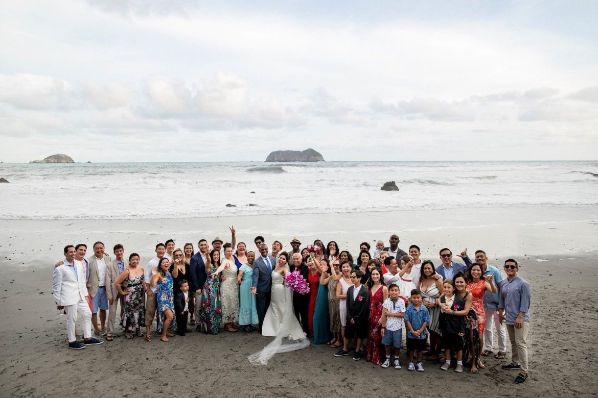 large group shot on the beach at destination wedding in costa rica