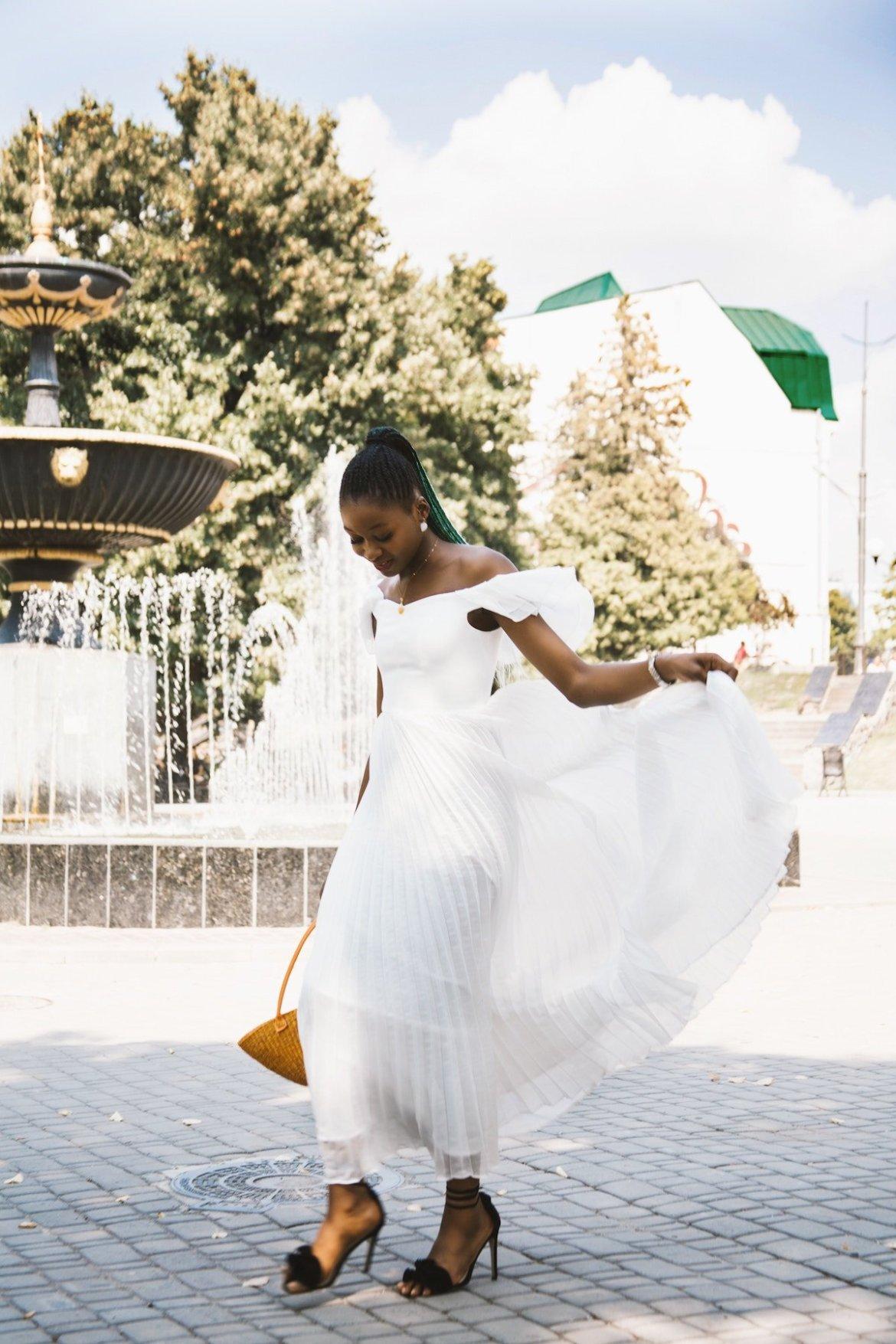 Lady wearing white wedding dress walking