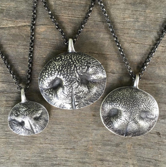 Kaleen Wolfe works closely with her clients to create custom, one-of-a-kind jewelry. One of her specialties? Nose print and paw print jewelry!