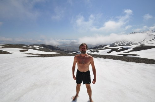 Wim Hof standing in the ice