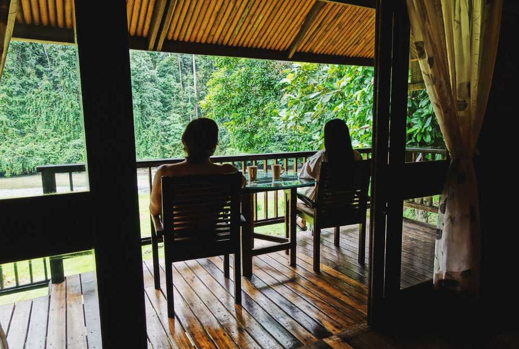 exploring borneo island river chalet balcony views