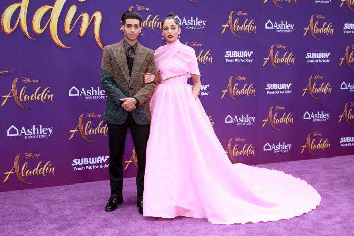 Mena Massoud and Naomi Scott attend the premiere of Disney's 'Aladdin'